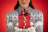 Woman with red package — Stock Photo