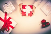 Red giftbox in female hands — Stock Photo