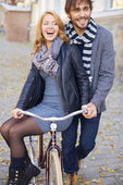 Man carrying girlfriend on bicycle — Stock Photo