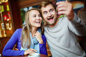 Couple taking selfie in cafe — Stock Photo