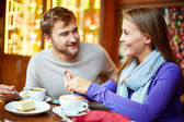 Couple spending time in cafe — Stock Photo