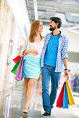 Couple walking in big mall — Stock Photo