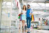 Couple walking in big mall — Stock Photo