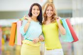 Two happy shoppers with paperbags — Stock Photo
