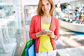 Customer with smartphone — Stock Photo