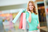 Girl carrying shopping bags — Stock Photo