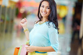 Woman with colorful shopping paperbags — Stock Photo