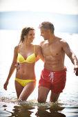 Couple having fun in water — Stock Photo