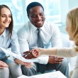 Businesswoman with partners at meeting — Stock Photo #59961801