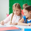 Cute girls sitting at drawing lesson — Stock Photo #59962799