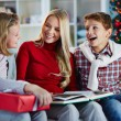 Family reading on Christmas evening — Stock Photo #59963877