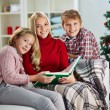 Family reading on Christmas evening — Stock Photo #59963905