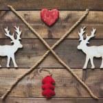 Wooden deer, heart, red fabric fir tree — Stock Photo #59964153