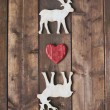 Wooden deer with red heart — Stock Photo #59964197