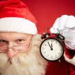 Santa showing alarm clock — Stock fotografie #59964739