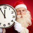 Santa holding clock with five minutes to midnight — Stock Photo #59964755