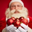Santa Claus holding red toy balls — Stock Photo #59964927