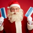 Santa Claus with two airline tickets — Stock Photo #59965095