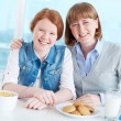 Teenage girl and mother during breakfast — Stock Photo #59967835