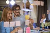 Co-workers reading reminders — Stock Photo