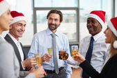 Colleagues celebrating New Year — Stock Photo