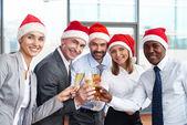 Business partners in Santa caps — Stock Photo