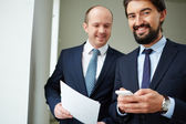 Businessmen in elegant suits — Stock Photo