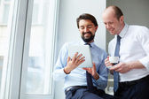 Businessmen looking on touchpad — Stock Photo