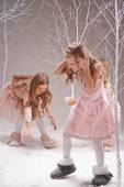 Girls playing snowballs — Stock Photo