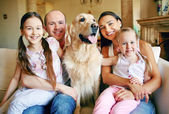 Family with dog resting at home — Stock Photo