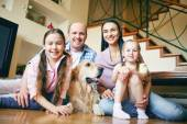 Family with dog at home — Stock Photo