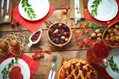Rennets, walnuts, pastry on festive table — Stock Photo