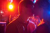 Couple kiss in nightclub — Stock Photo