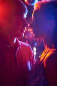 Couple in neon lights — Stock Photo