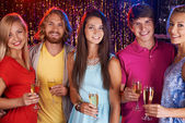 Friends holding champagne flutes — Stock Photo