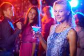 Woman with martini at nightclub — Stock Photo