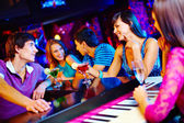 Young people at nightclub — Stock Photo