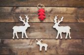 Wooden deer and red firtree — Stock Photo