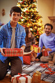 Boy with Christmas giftboxes — Stock Photo