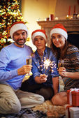 Family in Santa caps — Stock Photo