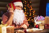 Santa Claus holding Christmas — Stock Photo