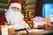 Santa  packing presents — Stock Photo