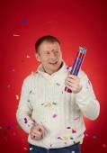 Man holding confetti cracker — Stock Photo