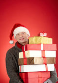 Santa man with pile of giftboxes — Stock Photo