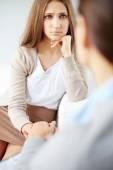 Sad woman looking at psychiatrist — Stock Photo
