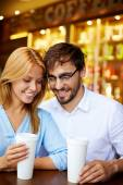 Restful couple  sitting in cafe — Stock Photo