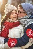Man kissing  girlfriend on cheek — Stock Photo
