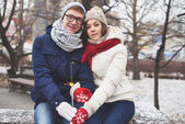 Young couple with Bengal ligh — Stock Photo