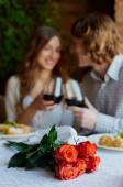 Fresh roses and young dates — Stockfoto