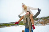Man carrying girlfriend on shoulders — Stock Photo